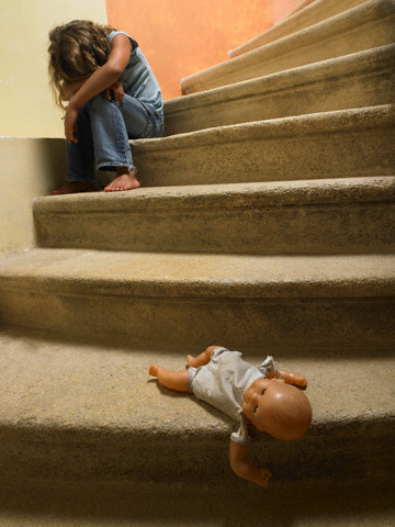Doll on the stairs, sad girl