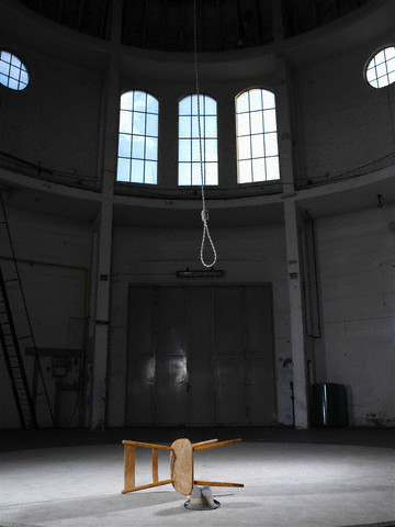 Still Life of Overthrown Chair Hat and Rope in Empty Building